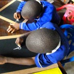 P1's writing in Mukono Boarding School's Literacy Center.