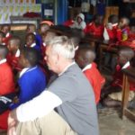 Lew observing instruction at Mukono Boarding Primary School.